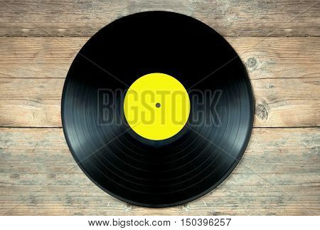 Close up of a vinyl record lp on a wooden table
