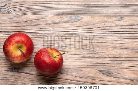 Red ripe apples on a wooden table. Fruit apples on the old board.