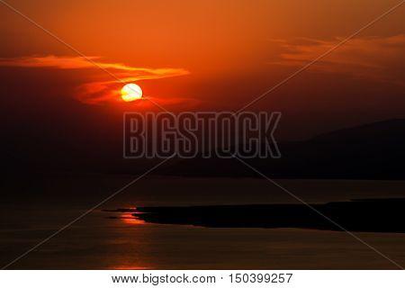Breathtaking red sunset over the lake of Iznik, Turkey
