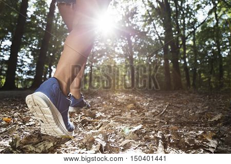 Young woman walks hike in the woods. close up .