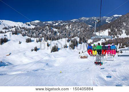 HOCH-YBRIG SWITZERLAND - February 26 2015- Skiers on ski chairlift in the Hoch-Ybrig mountain resort Switzerland
