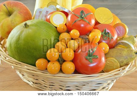 a fruits are the treasures of nature. fruits and chocolate coins in the basket