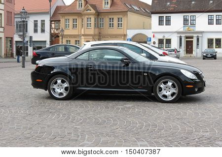 KOETHEN GERMANY - CIRCA MARCH 2016: black Lexus car parked on main square