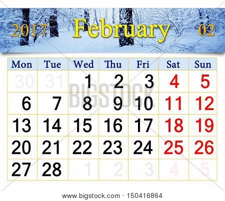 calendar for the February of 2017 on the background of snow-covered road and hoarfrost on the trees