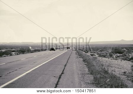 Distant traffic on a highway to Barstow in the Mojave Desert.