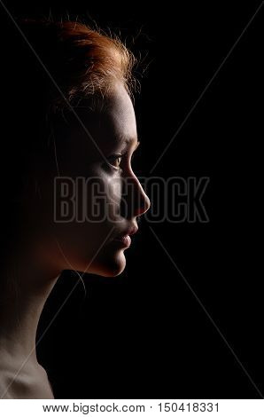 Profile Of Young Pensive Woman