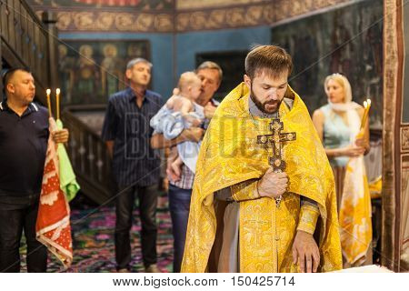 Chisinau MOLDOVA - September 10 2016: The Holy Orthodox rite of the sacrament of baptism newborn baby in a Christian Church.