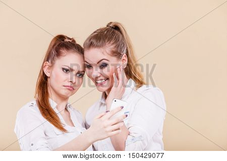 Girls Using Mobile Phone Reading Message
