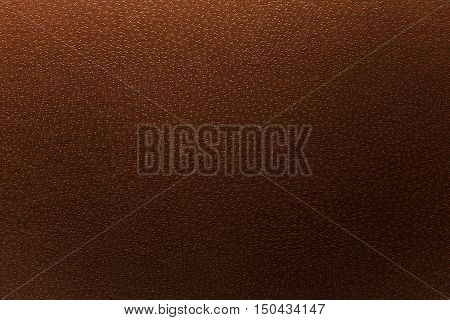 Details of a brown leatherette surface texture.
