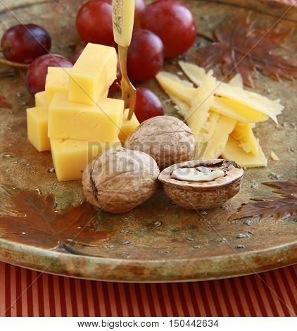 delicatessen cheese appetizer with fruit and walnuts