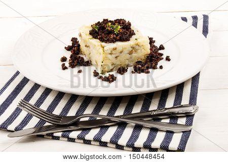 irish cuisine mashed potato and black pudding on a plate