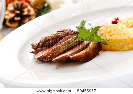 roasted duck breast on Christmas table