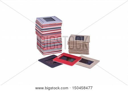 35 mm mounted film slides into the plastic and cardboard different colored frames isolated on white background cliping path embedded