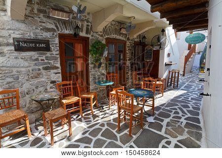 NAXOS, GREECE - SEPTEMBER 22, 2016: Caffee shop in the old town of Naxos on September 22, 2016.