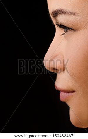 Beauty, vision, eyesight, ophthalmology and people concepts. Closeup profile of Korean or Asian woman wearing contact lenses in studio.