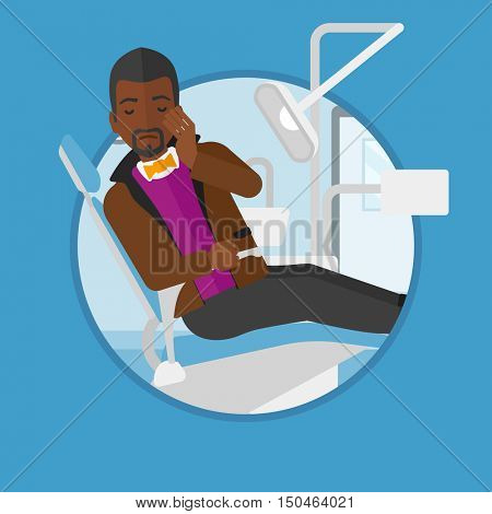 An african-american young patient sitting in dental chair. Sad man suffering from tooth pain. Man having a toothache. Vector flat design illustration in the circle isolated on background.