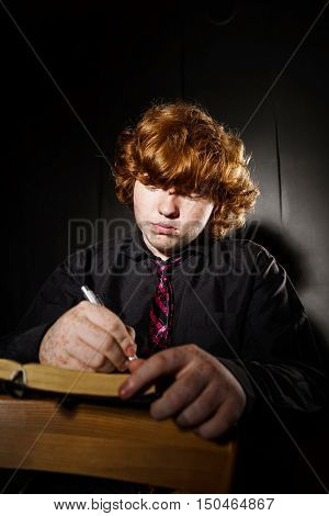 Freckled red-haired teenage boy reading book education concept isolated on black background poster