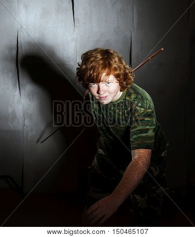 Red-haired Freckled Fat Boy Posing Like A Soldier