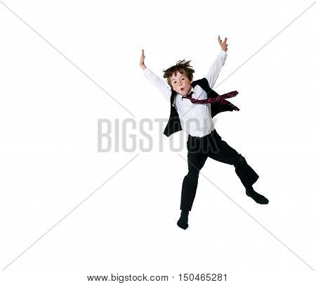 Expressive red-haired freckled boy shooting in the fly while jumping isolated on white background