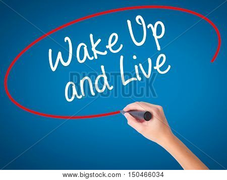 Women Hand Writing Wake Up And Live With Black Marker On Visual Screen.