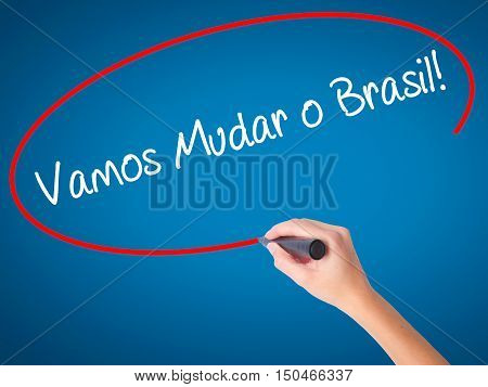 Women Hand Writing Vamos Mudar O Brasil! (let's Change Brazil In Portuguese)  With Black Marker On V