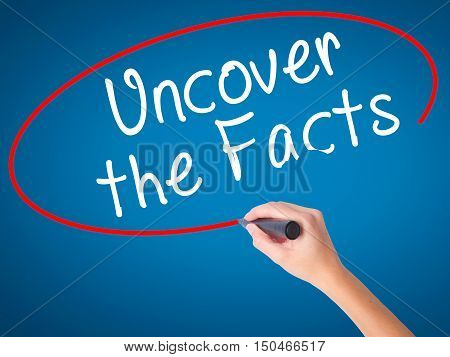 Women Hand Writing Uncover The Facts With Black Marker On Visual Screen