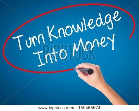Women Hand Writing Turn Knowledge Into Money With Black Marker On Visual Screen