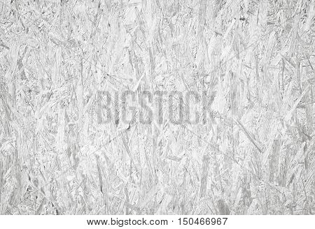 White recycled hardboard. Chipboard wall. Wooden texture