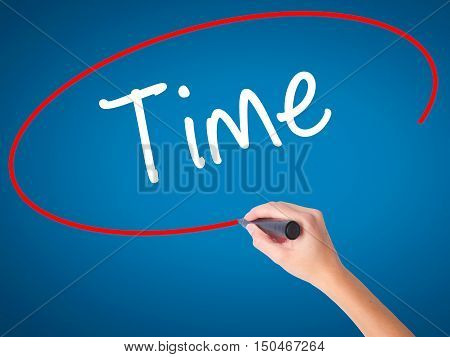 Women Hand Writing Time With Black Marker On Visual Screen