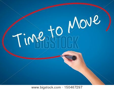 Women Hand Writing Time To Move With Black Marker On Visual Screen