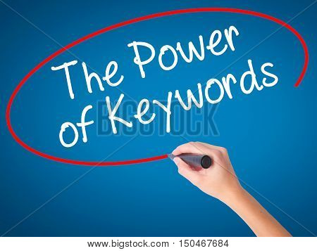 Women Hand Writing The Power Of Keywords With Black Marker On Visual Screen