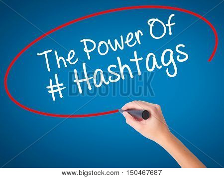 Women Hand Writing The Power Of Hashtags With Black Marker On Visual Screen