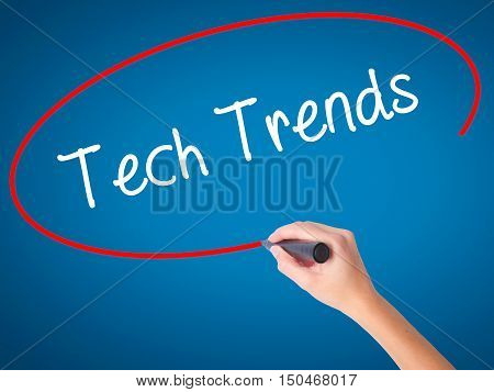 Women Hand Writing Tech Trends With Black Marker On Visual Screen