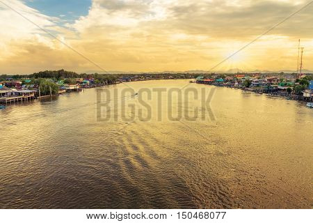 Panorama in evening of the Estuary of the river Tha Chin at Bang Ta Bun Phetchaburi Thailand in the background.