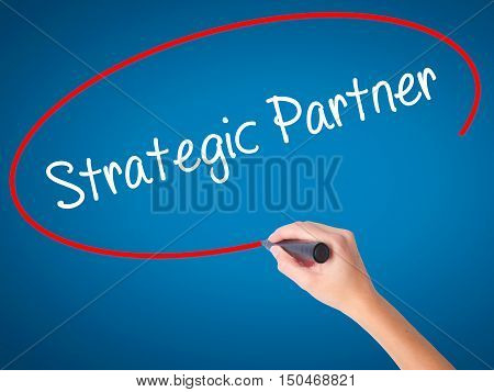 Women Hand Writing Strategic Partner With Black Marker On Visual Screen