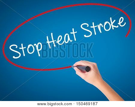 Women Hand Writing Stop Heat Stroke With Black Marker On Visual Screen.