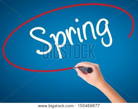 Women Hand Writing Spring With Black Marker On Visual Screen.