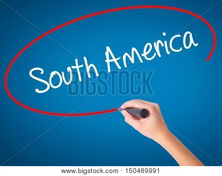 Women Hand Writing South America With Black Marker On Visual Screen