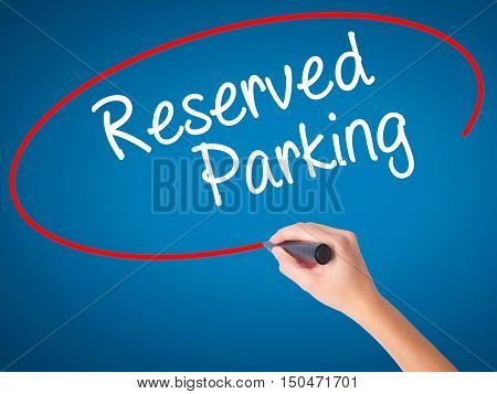 Women Hand Writing Reserved Parking With Black Marker On Visual Screen