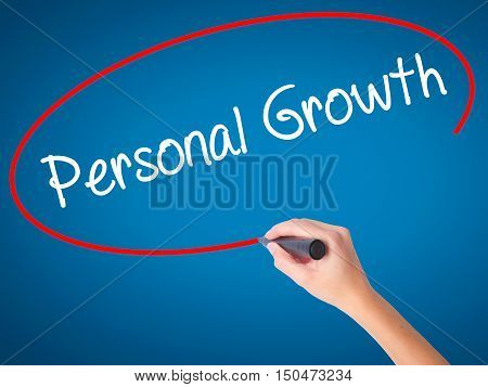 Women Hand Writing Personal Growth With Black Marker On Visual Screen
