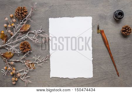 Chistmas background with handmade paper cone ink and pen oblique holder. Top view