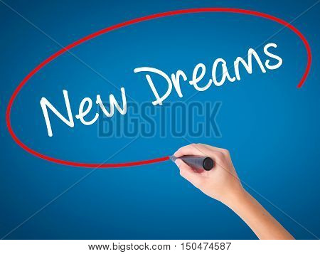 Women Hand Writing New Dreams With Black Marker On Visual Screen
