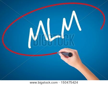 Women Hand Writing  Mlm (multi-level Marketing) With Black Marker On Visual Screen