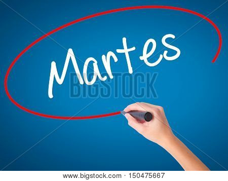 Women Hand Writing Martes (tuesday In Spanish) With Black Marker On Visual Screen