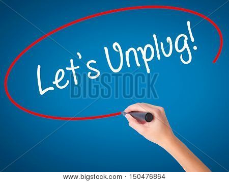 Women Hand Writing Let's Unplug! With Black Marker On Visual Screen