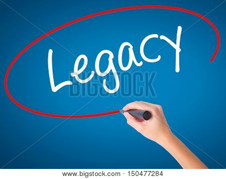 Women Hand Writing Legacy With Black Marker On Visual Screen