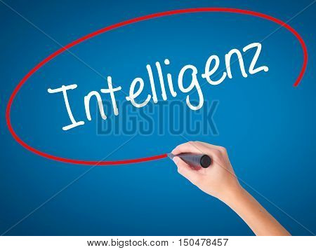 Women Hand Writing Intelligenz (intelligence In German) With Black Marker On Visual Screen