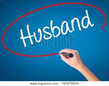 Women Hand Writing Husband With Black Marker On Visual Screen.