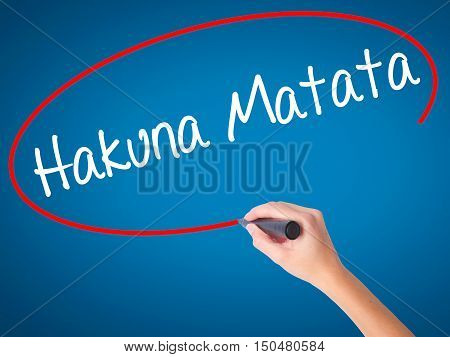 "Women Hand Writing Hakuna Matata (swahili Phrase; It Means ""no Worries"") With Black Marker"