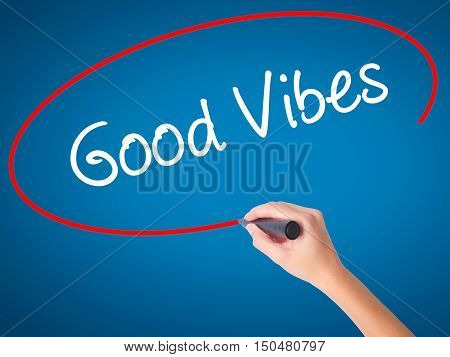 Women Hand Writing Good Vibes With Black Marker On Visual Screen